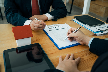 Real estate agents submit documents for customers to sign for a sale contract,real estate concept.