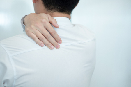 Businessman feel pain in their back while working in the office, medical concept