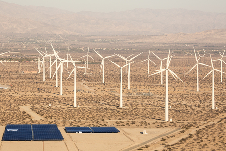 Power palnt, a Solar Panel and Windmill producing electrical energy  of  Palm Spring Callifornia desert aerial shot