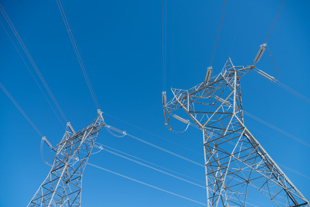 distributing: Twin grid electrical tower carrying and distributing high voltage electrical energy to house hold and industrial network