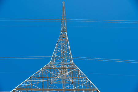 high powered: grid electrical tower carrying and distributing high voltage electrical energy to house hold and industrial network