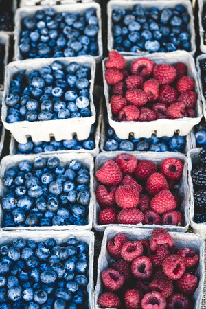 Blueberries background in small baskets for sale at market.