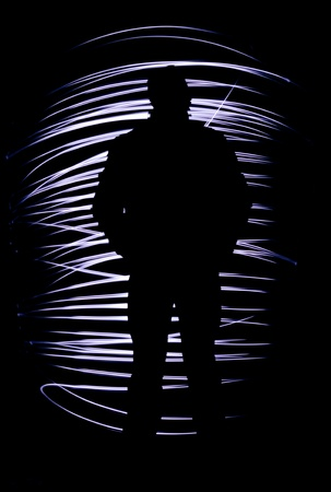 formidable: Silhouette of a man with freezelight on a black background