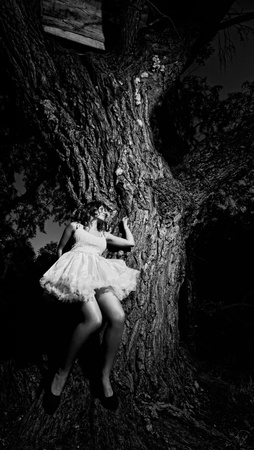 leaned: beautiful girl leaned against a large tree