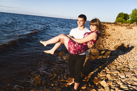 brings: lucky guy brings his girlfriend along the shore of Lake