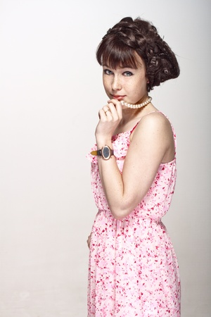 bright eyed: Beautiful girl posing in a pink dress Stock Photo