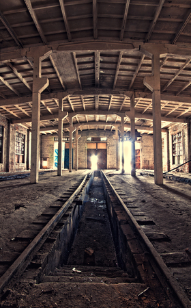 deepening: Inside an old abandoned depot with a view to the output Stock Photo