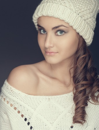 portrait of a girl in white winter hat and sweater Stock Photo