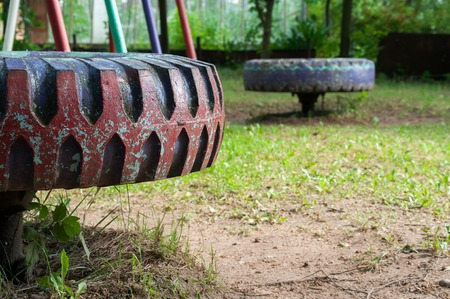 abandoned childrens playground with big wheel for spin