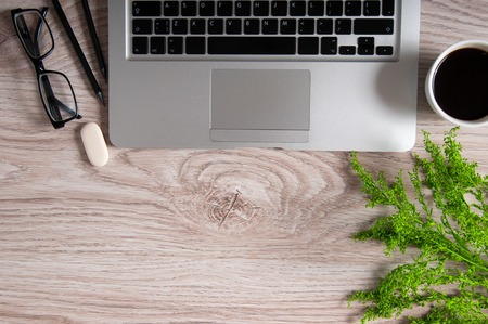 Notebook with hot coffee on wood table. Home business workplace concept 스톡 콘텐츠