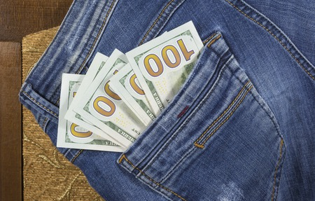 The money in the back pocket of blue jeans trousers Stock Photo