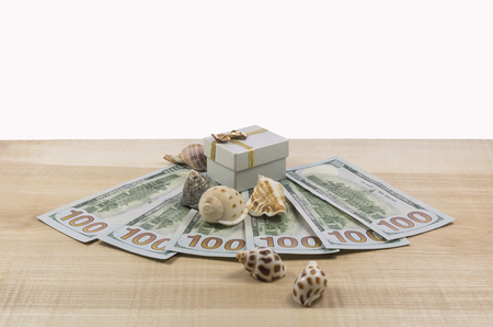 money on a white background with seashells