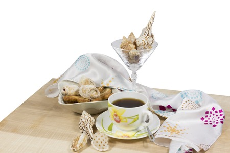 caffeine free: Tea with cookies on a wooden platter with a white background