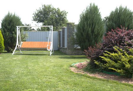 recreation area: Recreation area in the yard with a swing and a green lawn