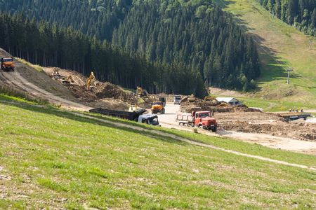 construction machinery high in the mountains Stock Photo