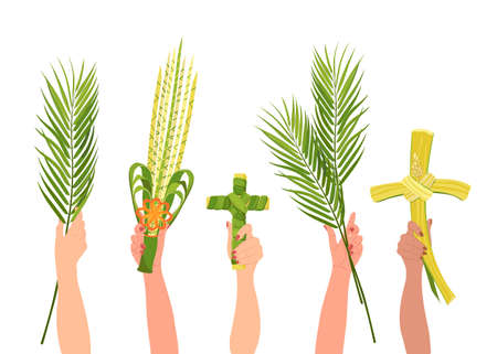 International Christian worshipers hold paraphernalia for Palm Sunday celebrations. The symbols of the holiday are a palm branch, a cross made of palm leaves and a wicker bouquet.