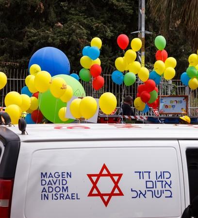 HOLON, ISRAEL - MARCH 2016: Ambulance on duty durring Adloyada (purim celebration parade)