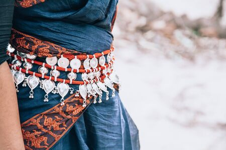 classic Indian Odissi dance costume with belt decoration. close up, copy space. classical Indian culture and traditions. Odissi dancer Stock Photo - 149912629