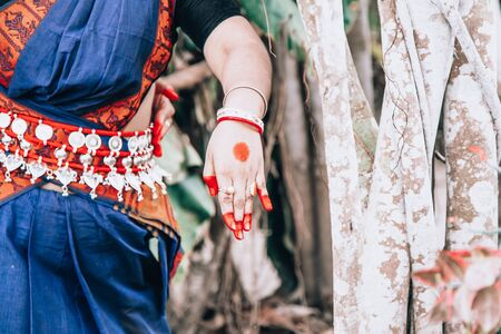 dance form indian classical hands with bracelets showing special symbols called mudra. close up, copy space. classical Indian culture and traditions. Odissi dancer
