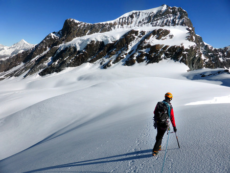 alpinist: SWITZERLAND,SAAS ALMAGELL - JULY 17th, 2014: Strahlhorn South East face Stock Photo