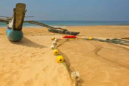 a fishing boat with nets on the beach of Sri Lanka photo
