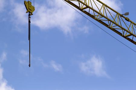 scaffolder: Crane ans construction site scaffolding element. Blue sky background. Construction or reconstruction concept Stock Photo