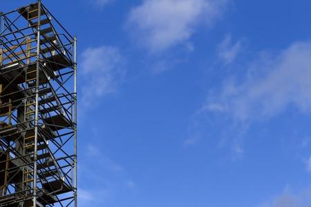scaffolder: Construction scaffolding element. Blue sky background. Construction or reconstruction concept Stock Photo