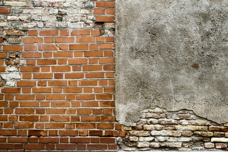 constructional: Grunge old bricklaying wall fragment from red bricks and damaged plaster background texture. Close up Stock Photo