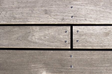 screwed: Closeup of a screw screwed into wooden plank.