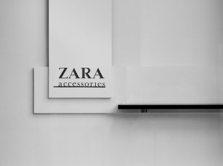 retailer: Vilnius, Lithuania - August 07, 2016: fragment of shopwindow of Zara store. Zara accessories sign. Zara is a Spanish clothing and accessories retailer based in Arteixo, Galicia, and founded in 1975 by Amancio Ortega and Rosali a Mera Editorial