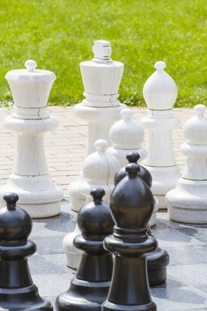 Outdoor giant chess board with big plastic pieces Stock Photo
