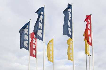 ikea: VILNIUS, Lithuania - September 18, 2016: IKEA flags against sky at the IKEA Vilnius Store. IKEA is the worlds largest furniture retailer. It was founded in Sweden in 1943.