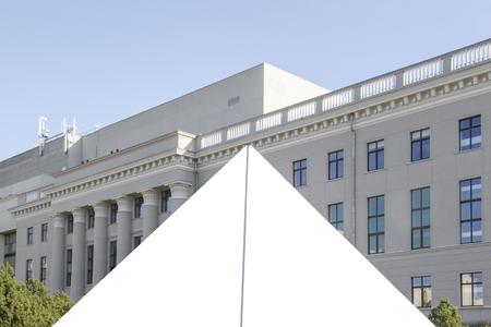 mocked: Mock up. Triangle shape. Blank billboard outdoors, outdoor advertising, public information board in the city