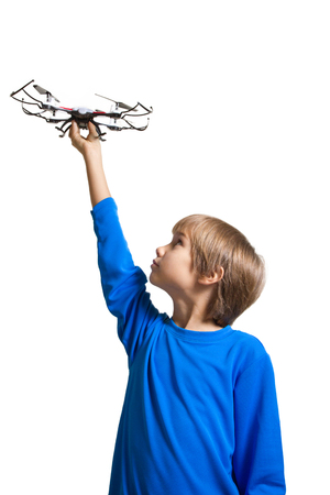Little kid with drone isolated on white
