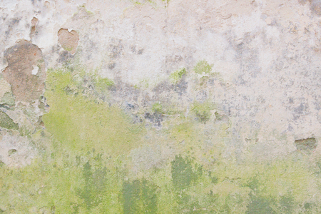 Old grungy wall with damaged plaster abstract horizontal background texture.