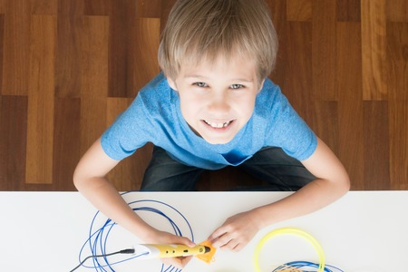 d: Child using 3D printing pen. Creative, technology, leisure, education concept Stock Photo