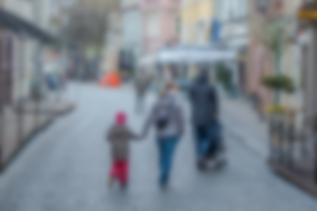 Blurred background. Blurred unrecognizable people walking through a city street. Reklamní fotografie