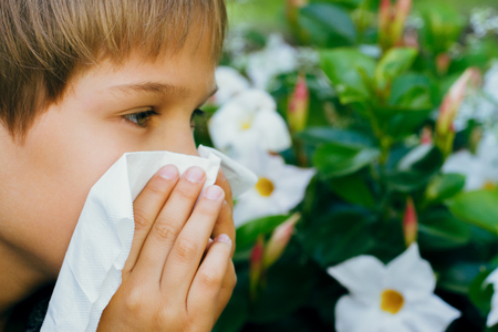 Child outdoor with tissue having allergy