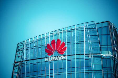 VILNIUS, LITHUANIA - July 30, 2017 : Huawei skyscraper in Vilnius city center. Modern office of the Chinese technology company Huawei Headquarters in Vilnius, Lithuania