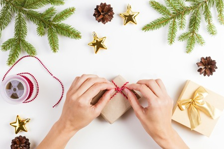 tradition: Gift wrapping. Woman packs gifts for Christmas