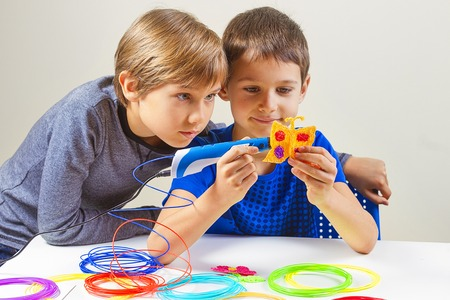 Children creating with 3d printing pen Stock Photo