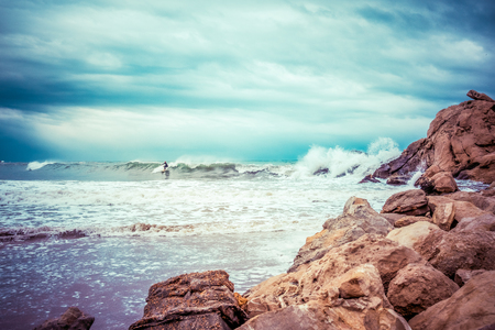 Sea wave crashing on rocks in La cala Finestrat, Spain.