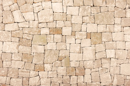 Masonry wall of colors stones with irregular pattern texture background Stock Photo