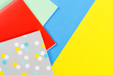 Colorful notebooks on blue and yellow background Stock Photo