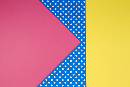 Abstract geometric yellow, pink and blue polka dot paper background. Stock Photo