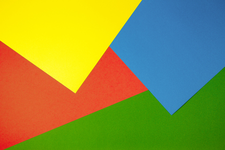 Color papers geometry flat composition background with yellow, green, red and blue tones