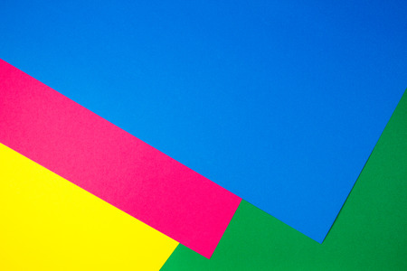 Color papers geometry flat composition background with yellow, green, pink and blue tones