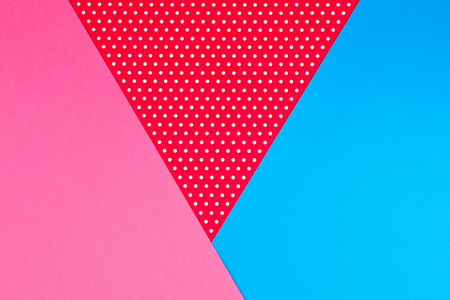 Abstract geometric blue, pink and red polka dot paper background.
