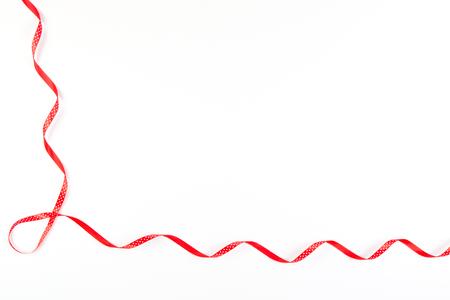 Red and white polka dot ribbon on white background Stock Photo