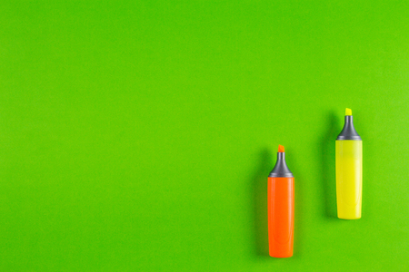 Markers highlighter pens on greenery background